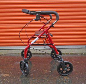 4-wheel walker with basket behind seat Image